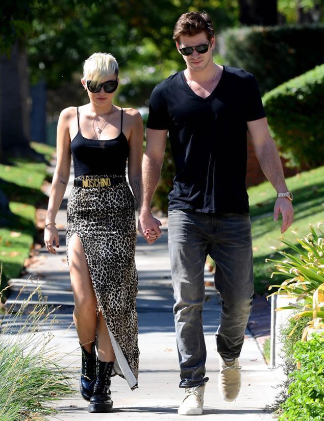 Miley Cyrus Leopard Split Maxi Skirt Moschino Belt Black Boots Liam Hemsworth StyleChi