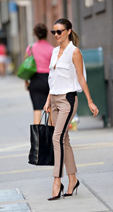 Miranda Kerr Sleeveless White Blouse Beige Trousers StyleChi