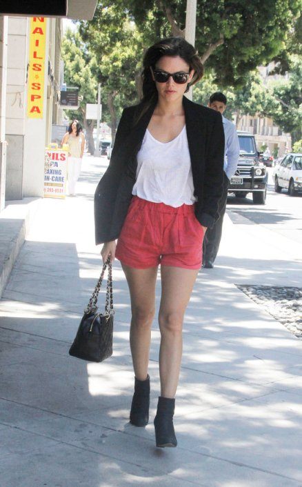 Rachel Bilson StyleChi Black Blazer Red Shorts Quilted Black Bag Black Suede Boots White T-Shirt