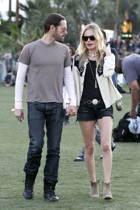 Kate Bosworth and director boyfriend Michael Polish stroll hand in hand as they make their way through the Coachella Music Festival