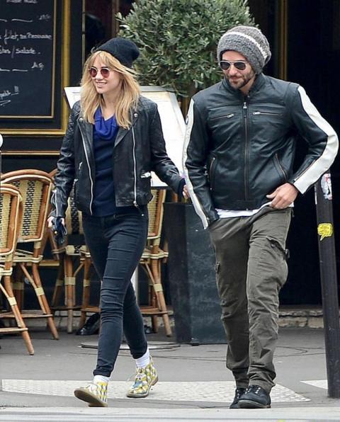 Suki Waterhouse StyleChi Bradley Cooper Paris Leather Jacket Black Beanie Jeans Blue Top Printed Shoes Sunglasses