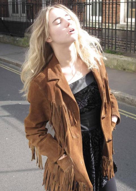 Suki Waterhouse StyleChi Tan Suede Fringed Jacket Patterned Black Dress