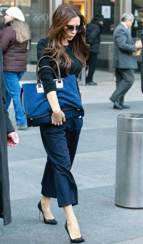 Victoria Beckham Blue Cropped Trousers Black Sweater Oversize Blue Bag Sunglasses StyleChi