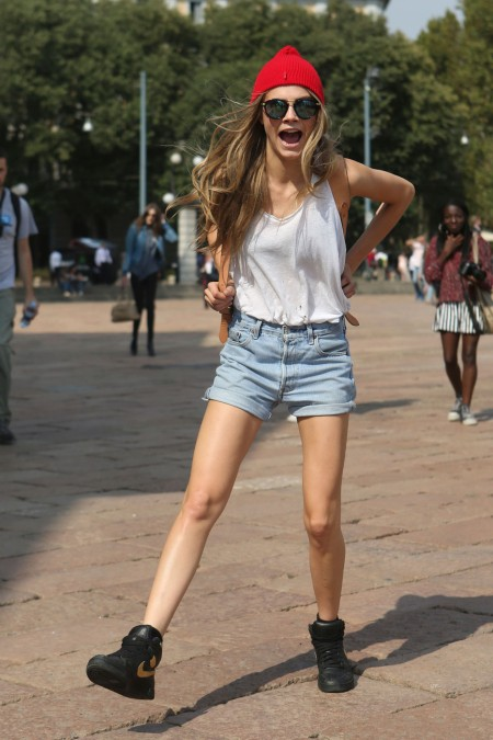 Cara Delevingne Style Chi Red Beanie Hat Black Gold Nike High Tops Light Blue Denim Fold Up Shorts White Tank Top Back Pack Round Sunglasses