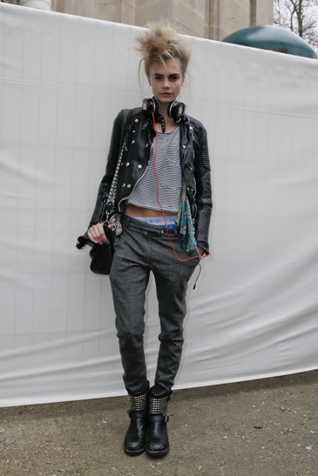 Cara Delevingne StyleChi Crazy Hair Black Leather Jacket Beats Headphones Studded Biker Boots Striped T-Shirt Grey Masculine Trousers Showing Jack Wills Blue Underwear