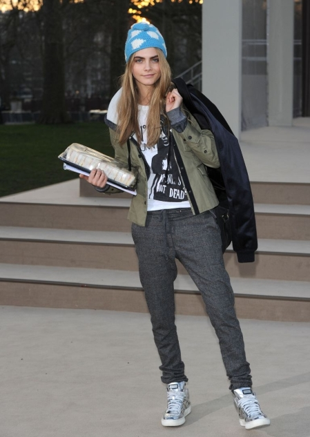 Cara Delevingne StyleChi Marl Grey Trousers Silver Metallic High Top Trainers Khaki Jacket Blue Hat Tomboy Look
