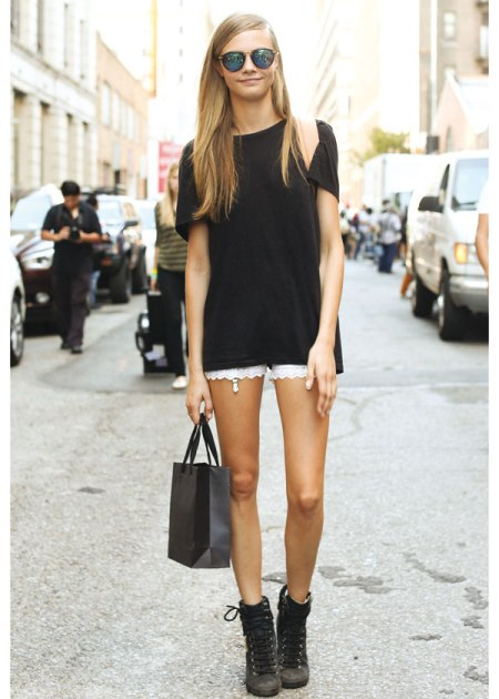 Cara Delevingne StyleChi Oversized Boyfriend Black T-Shirt Suspenders Black Trainers Petrol Sunglasses