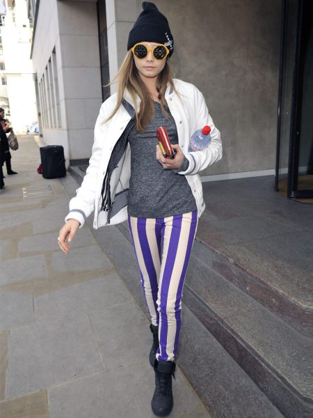 Cara Delevingne StyleChi Street Style Blue White Striped Skinny Jeans Black Trainers Marl Grey T-Shirt White Jacket Round Retro Sunglasses Orange Frames Black Beanie
