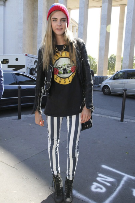 Cara Delevingne StyleChi Striped Skinny Trousers Black Lace Up Boots Leather Jacket Guns N Roses T-Shirt Statement Gold Necklace
