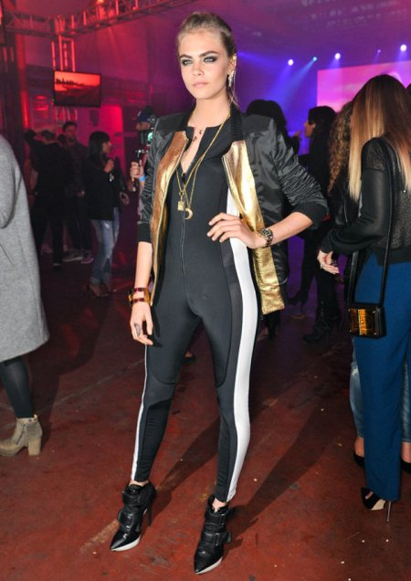 Cara Delevingne StyleChi Zipped White Strip Black Bodysuit Bomber Metallic Gold Jacket