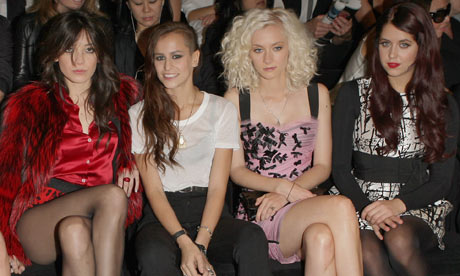 Daisy Lowe StyleChi Alice Dellal Red Furry Jacket Red Silk Blouse High Waist Animal Print Shorts Front Row Fashion Show