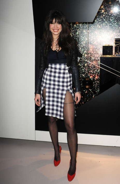Daisy Lowe StyleChi Swarovski Black Cropped Leather Jacket Buttoned Up Top High Waist Over Knee Black White Check Double Split Skirt Red Heels Multi Layer Necklace