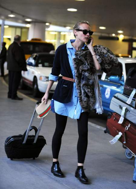Diane Kruger StyleChi Airport Style Casual Outfit Leopard Fur Coat Black Leather Brogues Leggings Blue Oversize Belted Shirt Cardigan Sunglasses