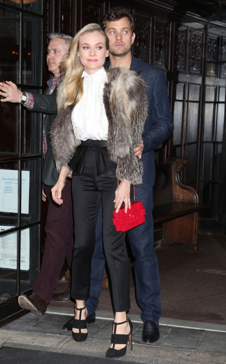 Diane Kruger StyleChi Joshua Jackson White Sleeveless Shirt Black Peplum Trousers Fur Coat Black Cut Out Heels Red Box Bag