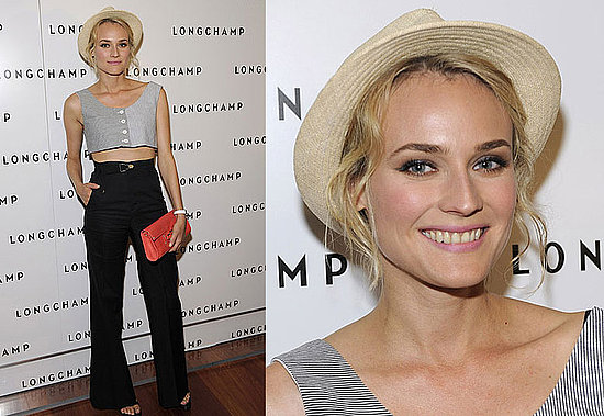 Diane Kruger StyleChi Straw Hat Buttoned Up Striped Monochrome Sleeveless Crop Top High Waisted Black Flared Trousers Open Toe Red Clutch