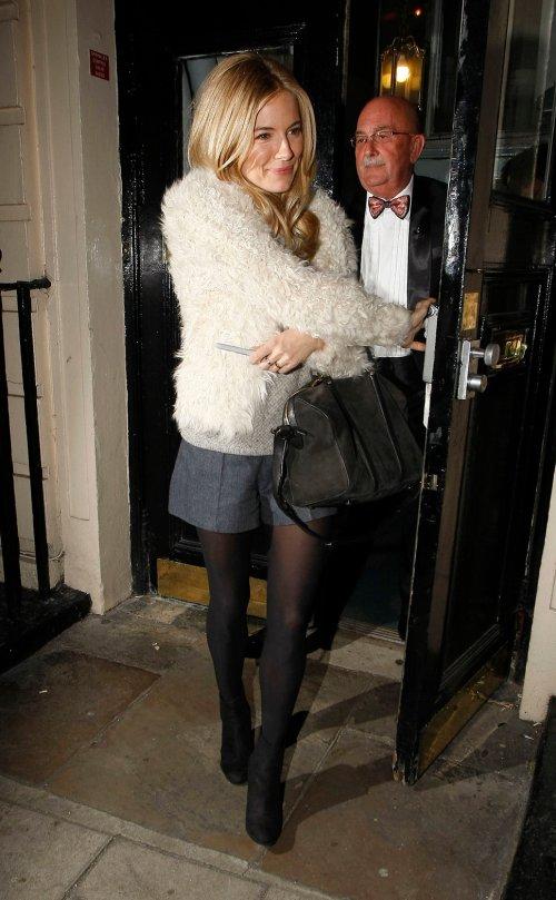 Sienna Miller StyleChi White Fur Jacket Grey Shorts Black Boots Bag
