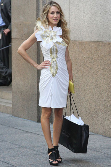 Carrie-Bradshaw-Sex-And-The-City-Sarah-Jessica-Parker-Best-Looks-StyleChi-White-Dress-Gold-Embellishment-Giant-Flower-Black-Dior-Gladiator-Heels