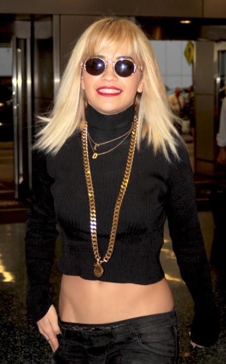 Rita Ora 2013 StyleChi Round Retro Sunglasses Black Ribbed Cropped Polo Neck Low Rise Black Jeans Statement Gold Chain
