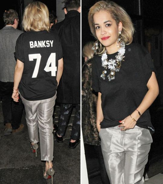 Rita Ora StyleChi Banksy Oversized Black T-Shirt Silver  Tapered Cropped Trousers Statement Floral Necklace Earrings