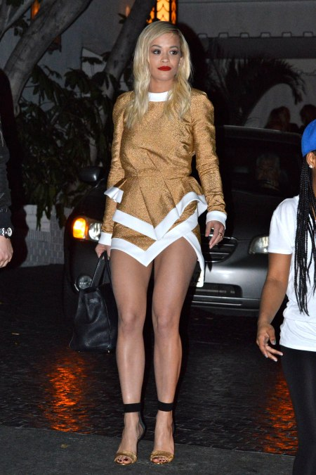 rita-ora-stylechi-gold-glittery-structured-long-sleeved-dress-white-trim-barely-there-black-heels