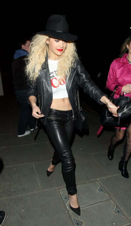 Rita Ora StyleChi Party Outfit Black Biker Jacket Leather Skinny Trousers Suede Pointed Heels Hat White Slogan Crop Top