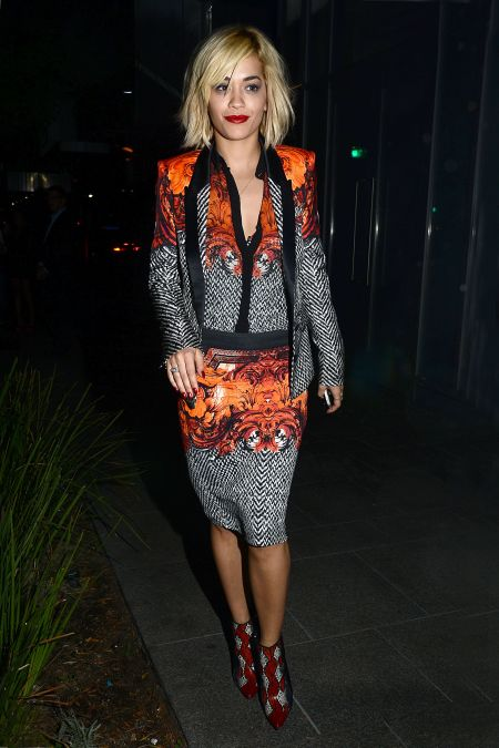 rita-ora-stylechi-roberto-cavalli-suit-orange-white-black-patterned-ensemble-red-shoe-boots