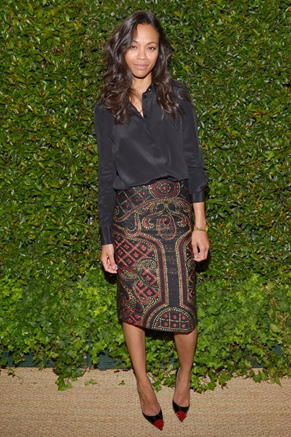 Zoe Saldana StyleChi Best Looks 2013 Vogue Black Loose Shirt Black Red Gold Patterned Skirt Pointed Heels Red Toe Cap