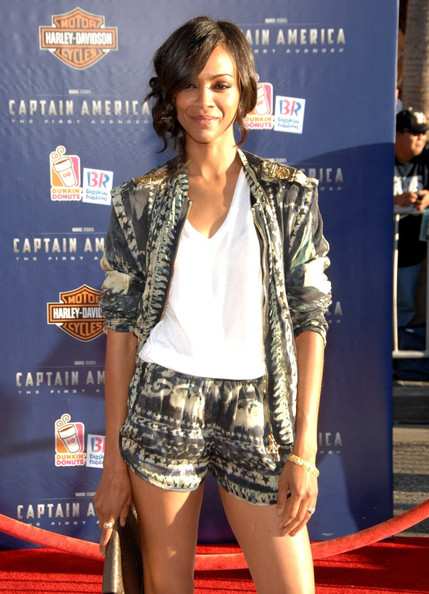 Zoe Saldana StyleChi Best Looks Red Carpet Graphic Print Blue Grey Charcoal Shorts Blazer Suit White V Neck T-Shirt