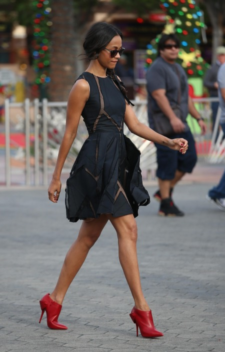 zoe-saldana-stylechi-best-looks-sleeveless-sheer-panel-deep-blue-charcoal-black-puff-out-mini-dress-sunglasses-plait-red-shoe-boots
