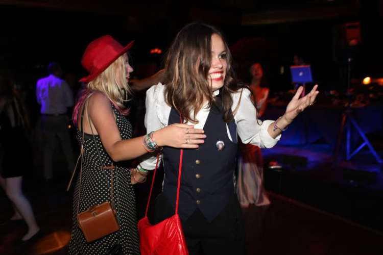Atlanta-De-Cadenet-Taylor-Best-Looks-StyleChi-White-Shirt-Navy-Waistcoat-Red-Bag
