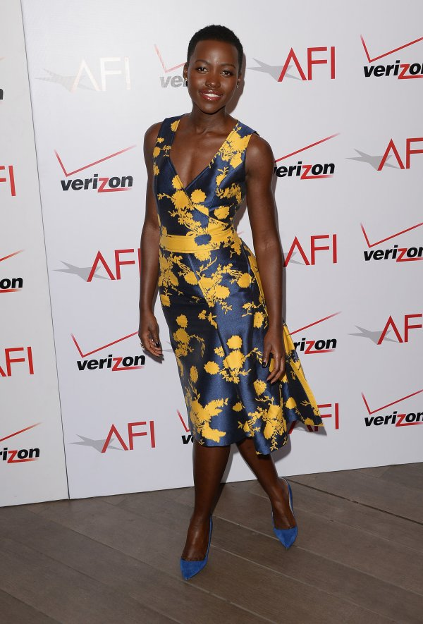 Lupita Nyong'O Red Carpet Best Looks StyleChi Blue Yellow Floral V-Neck Dress Matching Heels