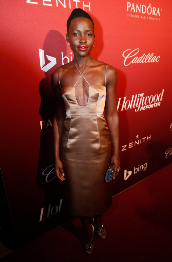 Lupita Nyong'O Red Carpet Best Looks StyleChi Bronze Satin Strappy Cross Front Dress
