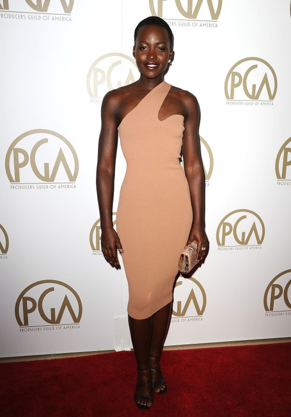 Lupita Nyong'O Red Carpet Best Looks StyleChi Nude Asymmetrical One Shoulder Dress Black Strappy Shoes
