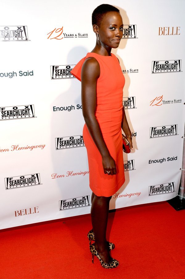 Lupita Nyong'O Red Carpet Best Looks StyleChi Orange Sleeveless Dress Leopard Print Shoes
