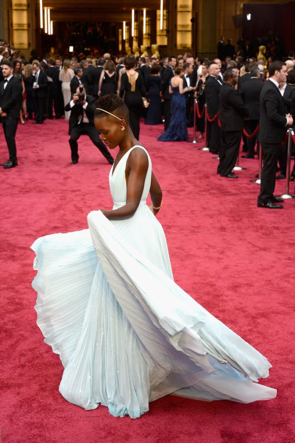 Lupita Nyong'O Red Carpet Best Looks StyleChi Oscars 2014 Light Blue Prada Pleated Deep Plunge V-Neck Dress
