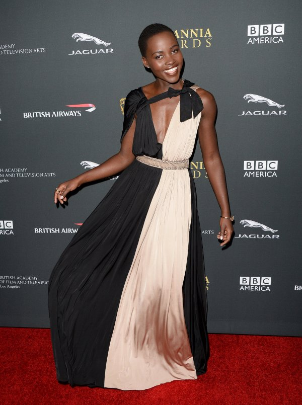 Lupita Nyong'O Red Carpet Best Looks StyleChi Pink Black Deep Plunge V-Neck Belted Gown