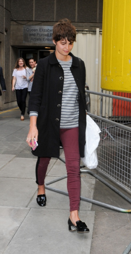 pixie-geldof-best-looks-stylechi-60s-black-mid-sleeve-coat-burgundy-ankle-grazer-skinny-jeans-nautical-grey-striped-top-heeled-mocassins-brunette-crop