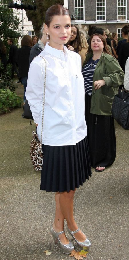 Pixie-Geldof-Best-Looks-StyleChi-Oversize-White-Shirt-Navy-Pleated-Midi-Skirt-Silver-Heels-Leopard-Bag-Brunette-Pulled-Back-Hair
