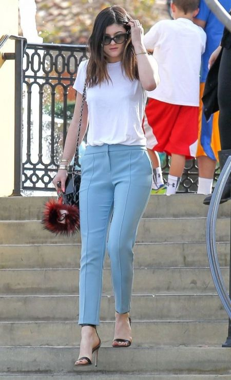 Kylie-Jenner-Best-Outfits-StyleChi-White-T-Shirt-Blue-Trousers-Sunglasses-Barely-There-Heels