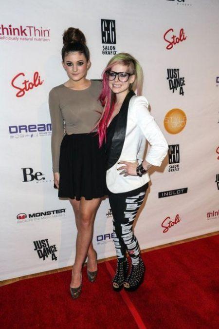 Kylie-Jenner-StyleChi-Best-Outfits-Style-Bun-Updo-Black-Skater-Skirt-Taupe-Top-Platform-Heels-Avril-Lavigne