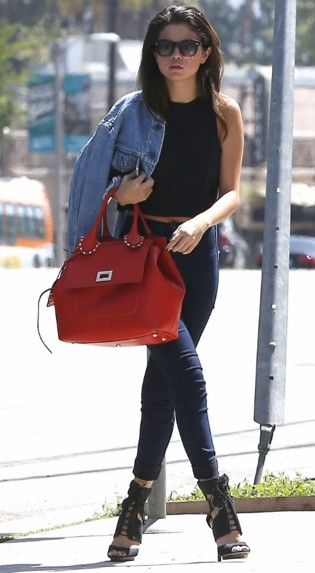 Selena-Gomez-Style-Street-Casual-StyleChi-Denim-Jacket-High-Waist-Navy-Skinny-Jeans-Red-Handbag-Black-Crop-Top-Heels-Sunglasses