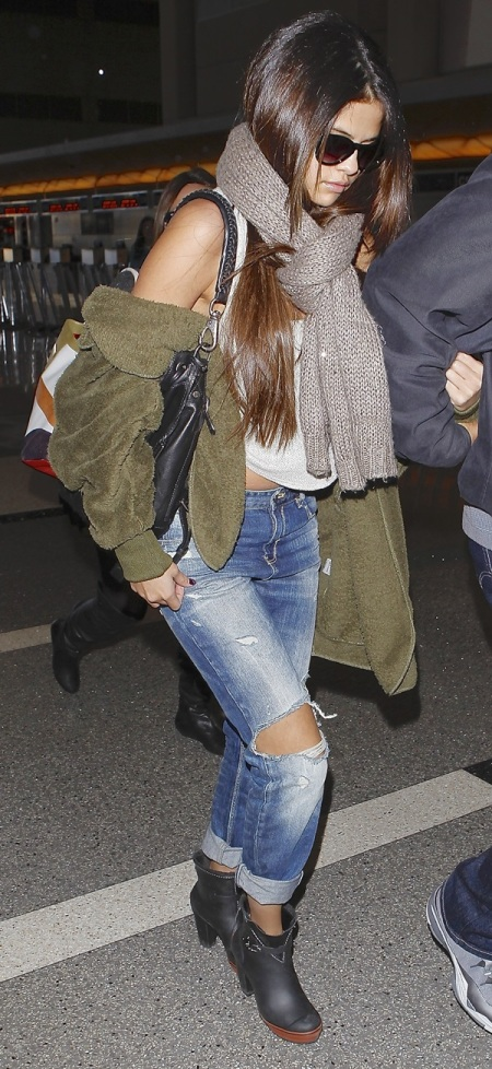 Selena-Gomez-Style-Street-Casual-StyleChi-Khaki-Jacket-White-Top-Ripped-Boyfriend-Jeans-Black-Ankle-Boots-Taupe-Scarf-Sunglasses-Airport