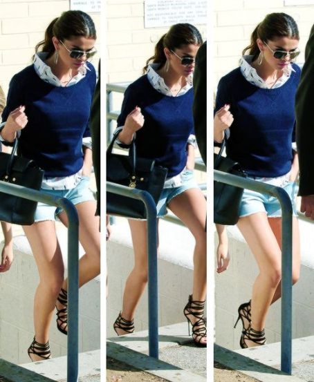 Selena-Gomez-Style-Street-Casual-StyleChi-Navy-Sweater-Aviator-Sunglasses-Denim-Shorts-Strappy-Black-Sandals-Hoop-Earrings