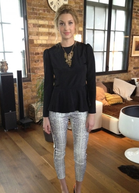 Whitney-Port-Style-Best-Outfits-StyleChi-Black-Long-Sleeve-Peplum-Top=Snake-Cropped-Skinny-Trousers-Gold-Statement-Necklace