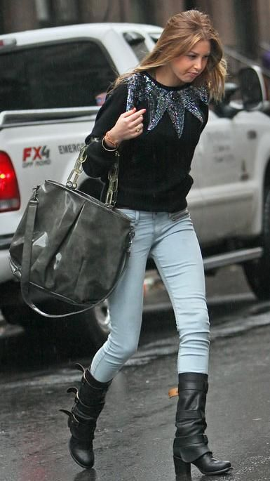 Whitney-Port-Style-Best-Outfits-StyleChi-Embellished-Black-Sweater-Light-Blue-Skinny-Jeans-Buckled-Heeled-Boots-Oversize-Patent-Grey-Bag