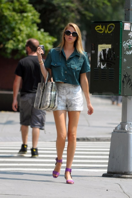 Whitney Port struts her stuff down a sidewalk in Soho, wearing purple sandals and carrying a snake skin bag