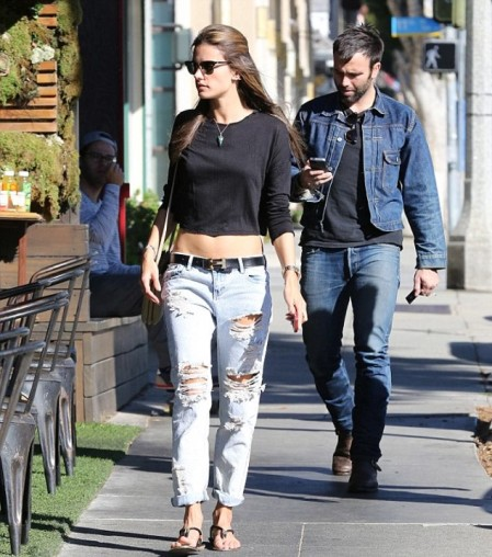 Alessandra-Ambrosio-Best-Outfits-Style-StyleChi-Black-Long-Sleeve-Crop-Top-Ripped-Bleached-Boyfriend-Jeans-Sandals