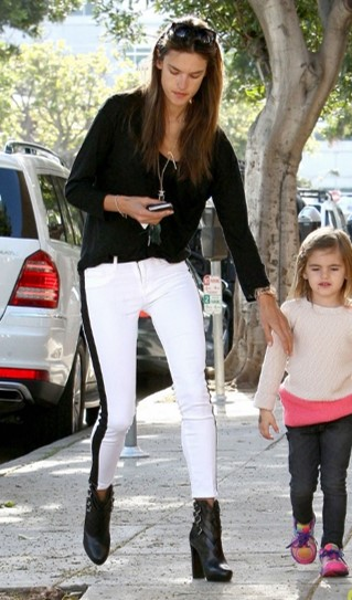 Alessandra-Ambrosio-Best-Outfits-Style-StyleChi-Black-Top-White-Jeans-Side-Stripe-Buckled-Boots