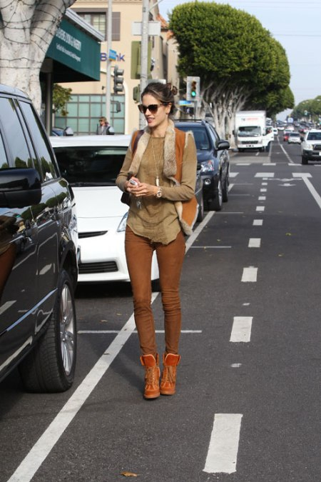 Alessandra-Ambrosio-Best-Outfits-Style-StyleChi-Brown-Sheepskin-Gilet-Top-Skinny-Jeans-Trainer-Wedges