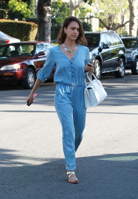 Jessica-Alba-Style-StyleChi-Best-Outfits-2014-Light-Blue-Denim-Long-Sleeve-Jumpsuit-White-Handbag-Silver-Sandals-Spike-Necklace